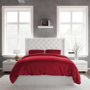 White queen size bed with red bamboo sheets