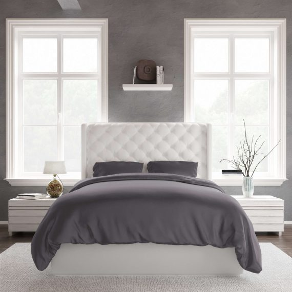 A bed in a room using a bamboo duvet set in charcoal.