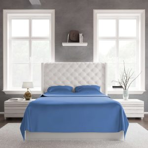 A white bed using bamboo cooling sheets set in darkblue