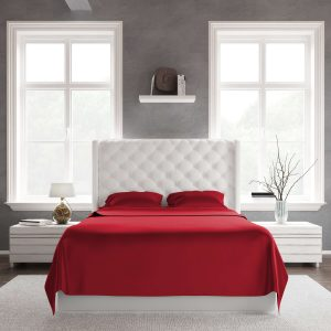 A bed in a room using red bamboo sateen sheets