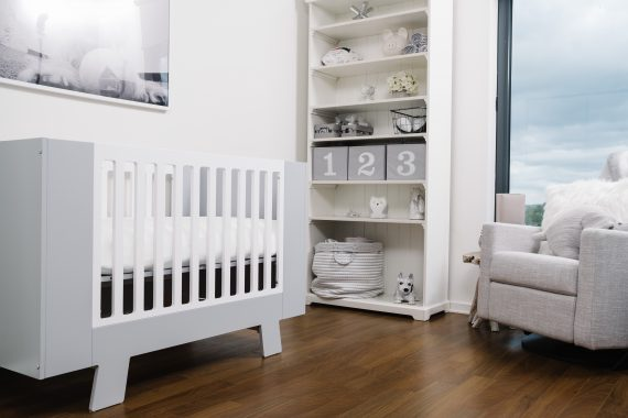 Crib using one of the best bamboo crib sheets in white