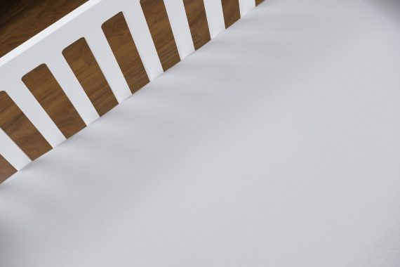 White crib using organic bamboo baby sheets